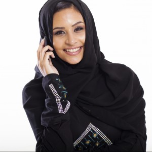 attractive modern muslim woman talking on cell phone